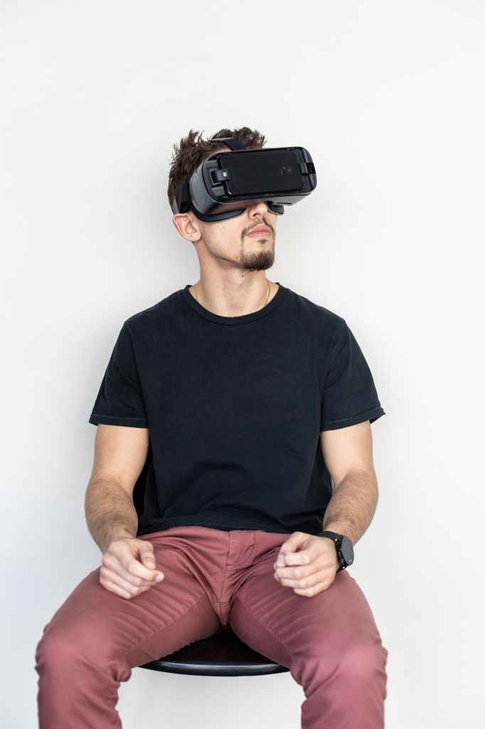man sitting with vr goggles on